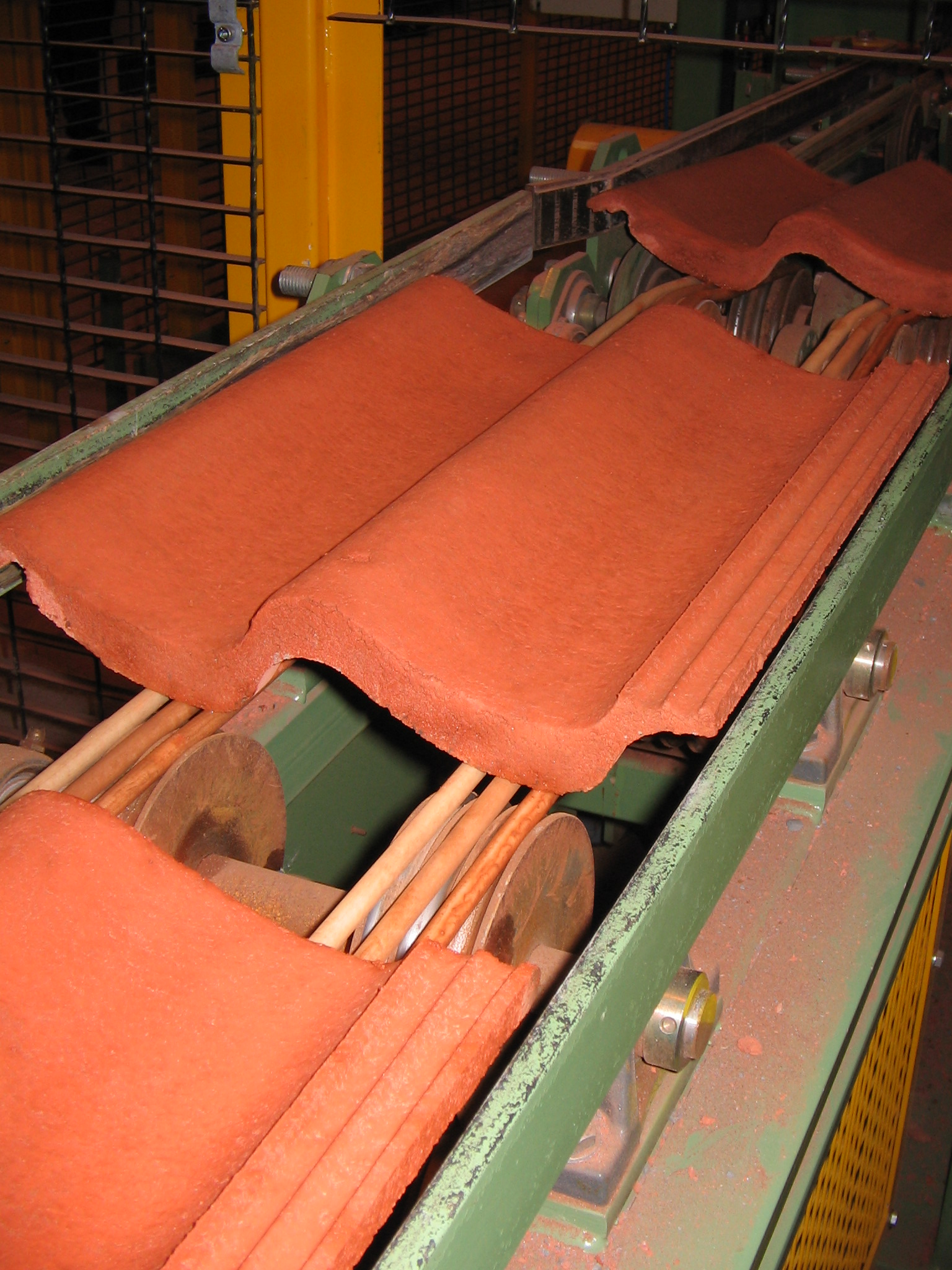 Tile conveying solutions eagle orange on a roof tile conveyor dailygadgetfo Images
