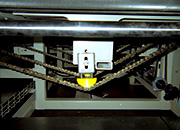 T-Max Chain Tensioner installed on a wood processing machine