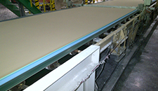 Eagle Taper Edge Band on wallboard forming line
