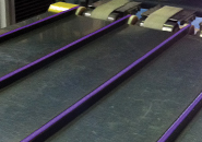 Trackstar UHMW Belt Guides with Tango Conveyor Belting on a Packaging Conveyor